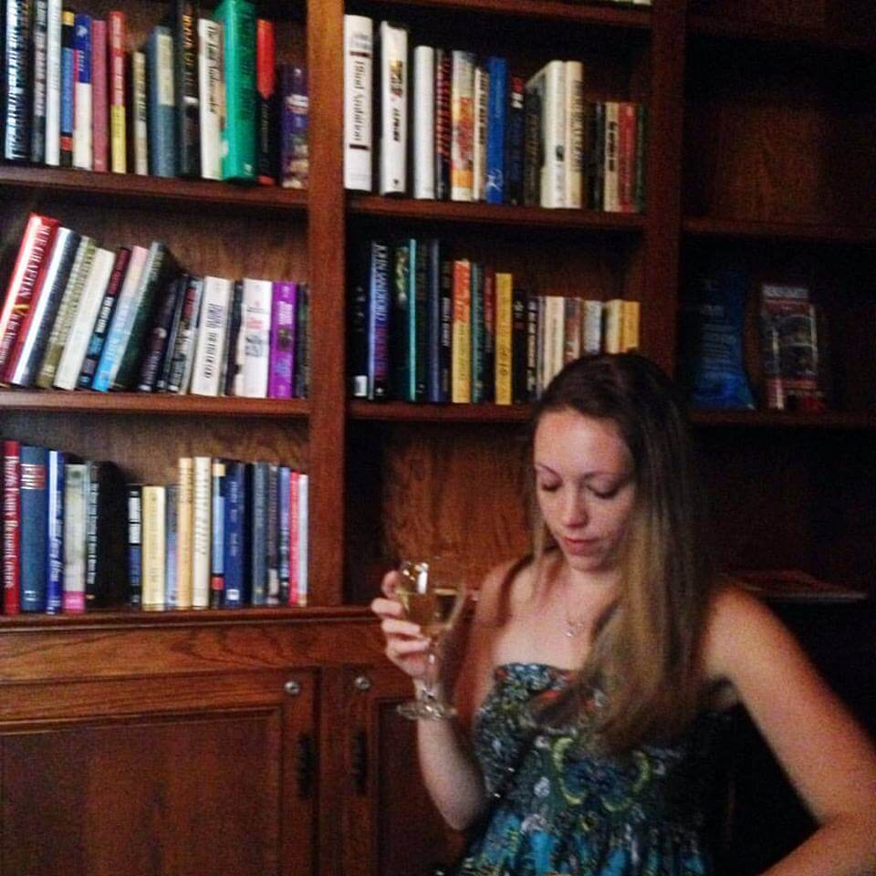sipping wine at May Bailey's Place library