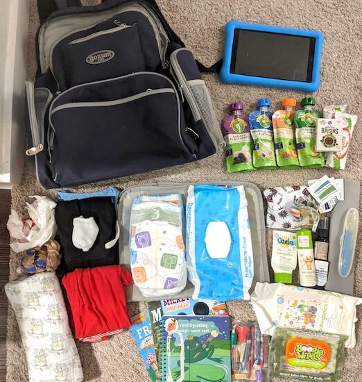 What we pack in our road trip diaper bag for our baby and toddler