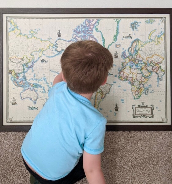 a DIY push pin travel map is a great way to involve your kids in travel planning