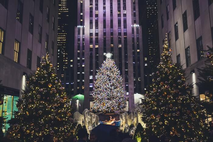 visiting the iconic new york city christmas tree at rockefeller center is a must.