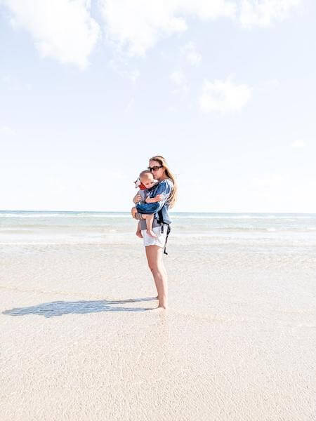 wearing the infantino cuddle up carrier on the beach in South Padre Island