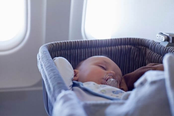bassinet seats are available for baby's first flight under six months and 20 pounds