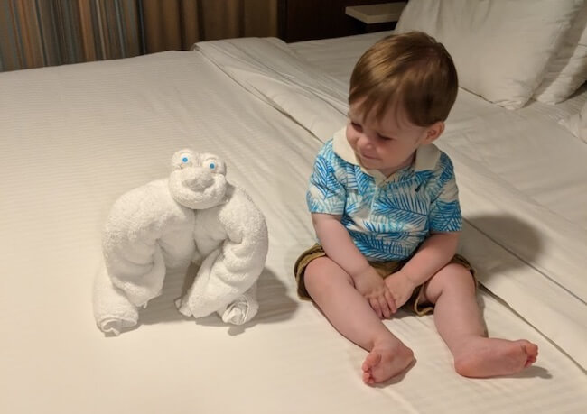 baby and towel animal in cruise cabin